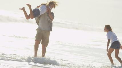 Happy Caucasian Father Girls Fun Playing Outdoors Summer Beach