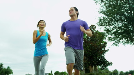 Active Asian Chinese Couple Outdoors Jogging
