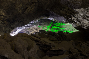 Kungur Ice Cave. Green light in the cave wall