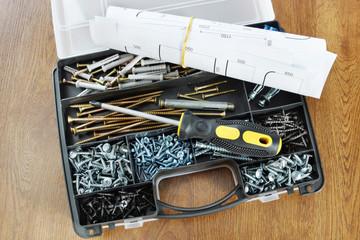 Plastic organizer with various screws and screwdriver