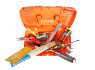Plastic toolbox with various working tools isolated over white
