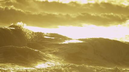 Sunset Light Over Gentle Ocean Waves