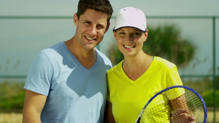 Young Caucasian Male Female Outdoor Tennis Players Close Up
