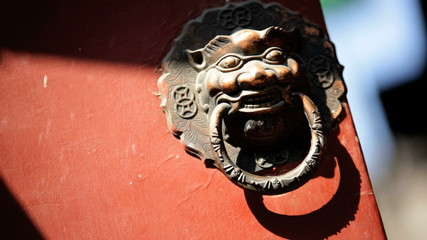Chinese brass knocker symbol of the past Imperial Lion Beijing China