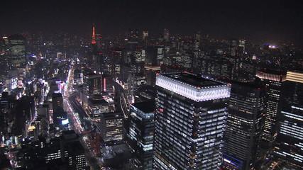 Aerial Metropolis illuminated skyscrapers Tokyo Tower Business District Japan
