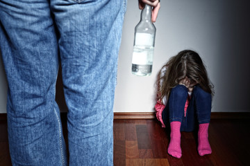 Drunk father standing over a crying daughter