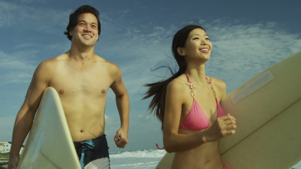 Young Ethnic Male Female Surfers Beach Ocean