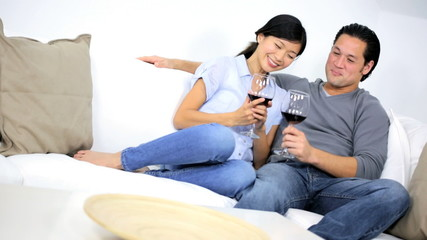Asian Chinese Couple Drinking Red Wine Home Sofa