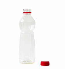 Empty plastic bottle opened with red cap.