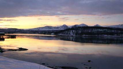 Fjord coastal resort nr Tromso sunset skyline Norway panning