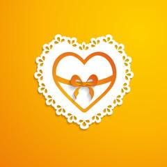 decorative paper heart on the orange background