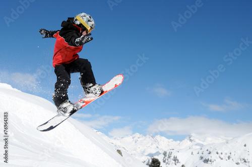 Leinwandbild Motiv Snowboard-Kid springt
