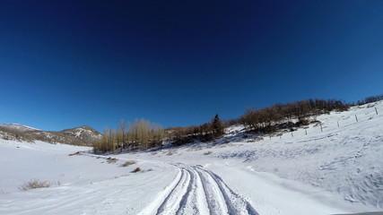 POV driving snowy landscape altitude blue dry climate vehicle transport Utah USA
