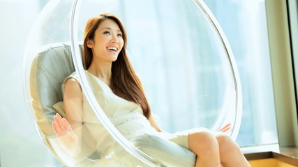Asian Chinese Female Relaxation Modern Chair Luxury Apartment Lifestyle
