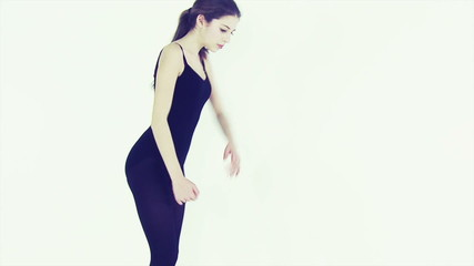 Professional teenager dancer in studio moving slow motion