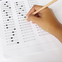 Standardized test form with answers bubbled in and a pencil, foc