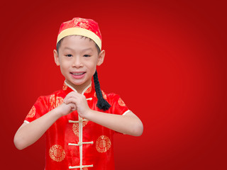 Happy Chinese new year.Young Asian boy with gesture of congratul