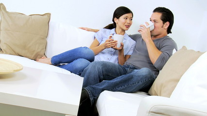 Asian Chinese Couple Drinking Coffee Home Sofa