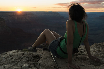 Girl watching sunset at Grand Canyon