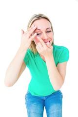 Happy blonde applying contact lens