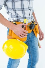 Technician with tool belt around waist and hard hat