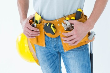 Technician with tool belt around waist
