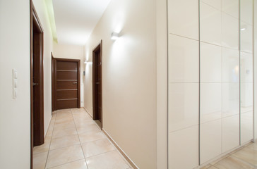 Long anteroom inside bright apartment