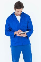 Mechanic using digital tablet over white background
