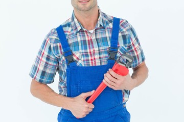 Cropped image of plumber holding monkey wrench
