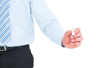 Businessman in shirt writing with a marker