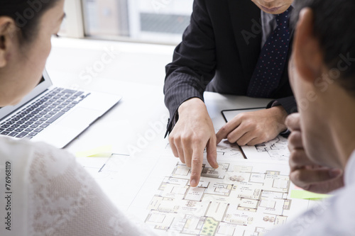 Couple who are considering a real estate investment Poster