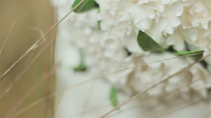 Weddding bouquet of white flowers lying on autumn grass