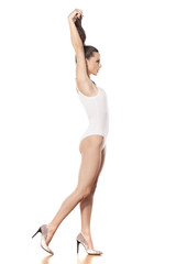 young beautiful lady in white monokini holding her ponytail