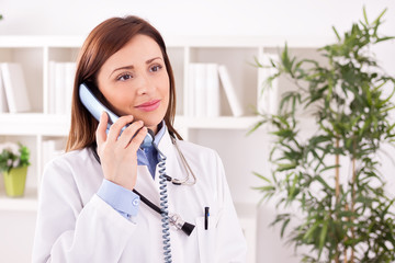 Smiling attractive female doctor talking with patient and schedu