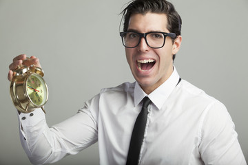 young businessmen  holding alarm clock stressed out