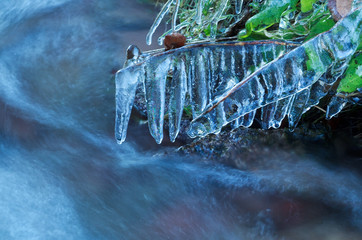 icicles by mountain river in winter