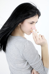 Fashion model with cigarette in mouth and wind in air