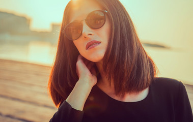 Beautiful brunette woman with hairstyle in sunglasses