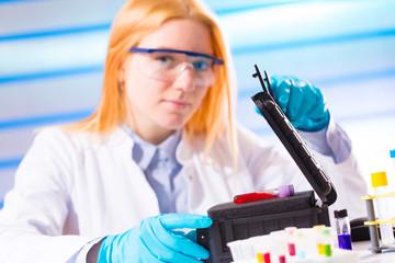 bottle of hazardous substances / ebola virus / on the hands of a