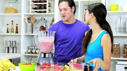 Healthy Ethnic Couple Homemade Smoothie Together