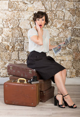 Beautiful woman with suitcases