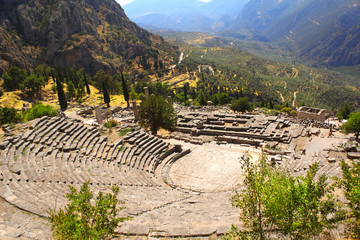 Ancient amphitheater and ruins of Temple of Apollo in Delphi, Gr