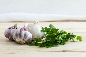 Composition of purple garlic with parsley