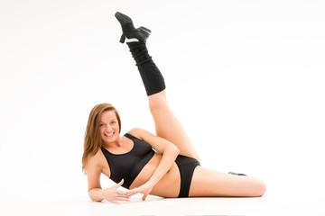 girl standing knee lifts leg up