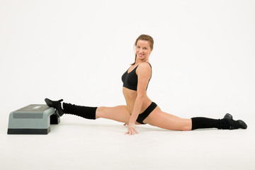 young woman sits on splits