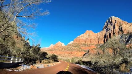 POV vehicle road drive sandstone rock extreme terrain Zion National Park Utah USA
