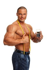 Handsome muscular man with meter and shows you calculator