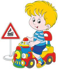Boy on a toy train