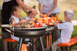 Leinwandbild Motiv Family having a barbecue