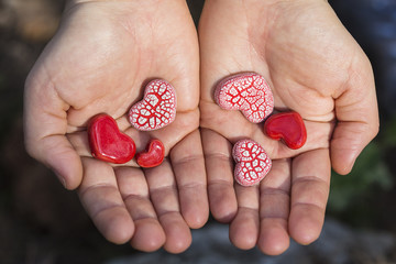 Hands Holding Red Hearts